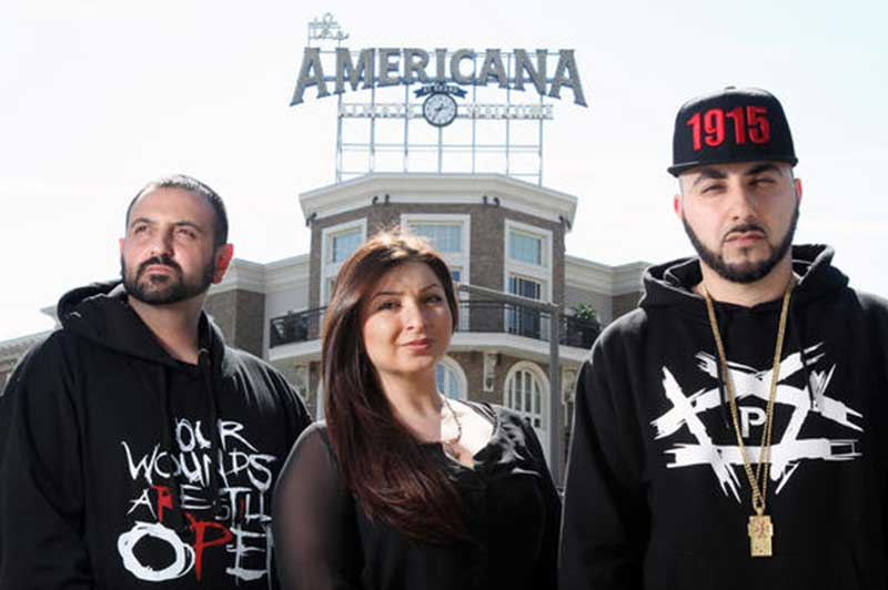 "Alex Kodagolian, Tina Chuldzhyan and Armin Hariri, a rapper also known by his stage name ""R-Mean,"" stand across the street from the Americana at Brand after they were told to stop displaying T-shirts referencing the Armenian Genocide on Thursday, March 12, 2015. (Roger Wilson / Staff Photographer / March 12, 2015)"