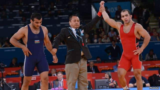 """""""No matter how much they say that there will be equal conditions, it is one thing to say it and another thing to do it,"""" says Armenian wrestler Arsen Julfalakian (right), an Olympic silver medalist."""