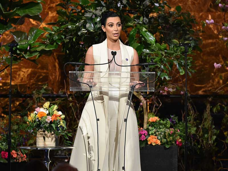 Kim-Kardashian-on-chest-forget-me-not-flower-armenian-genocide-symbol