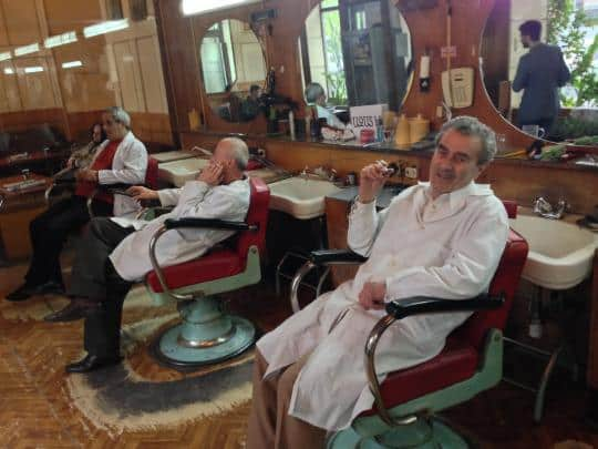 Master barber Kachik Aristakesyan, right, and his team deliver haircuts and wisecracks at a fast pace.