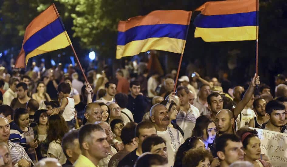 Protesters wave Armenian national flags during a rally in Yerevan, Armenia, on July 1, sparked by a proposed hike in the price of electricity sold by a Russian monopoly. The Iran nuclear deal offers a chance for the West to engage with the countries of the South Caucasus. HAYK BAGHDASARYAN/REUTERS