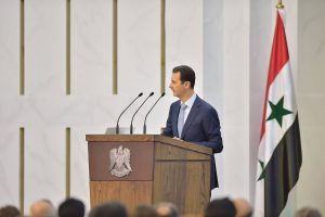 Syrian President Bashar al-Assad speaks in Damascus in this handout released by Syria's national news agency on Sunday <a class=