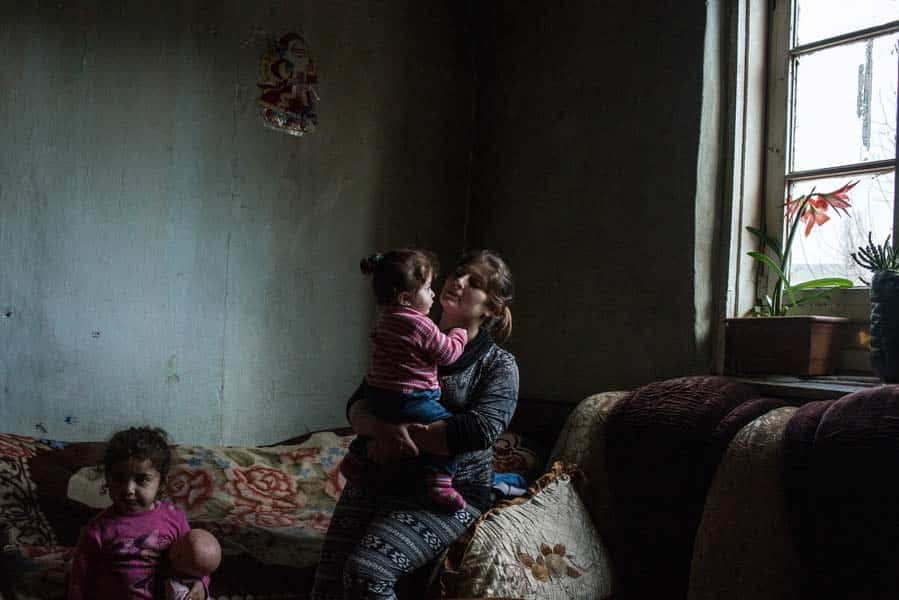 Hripsime Aslanyan sits with her children in Madagis <a class=